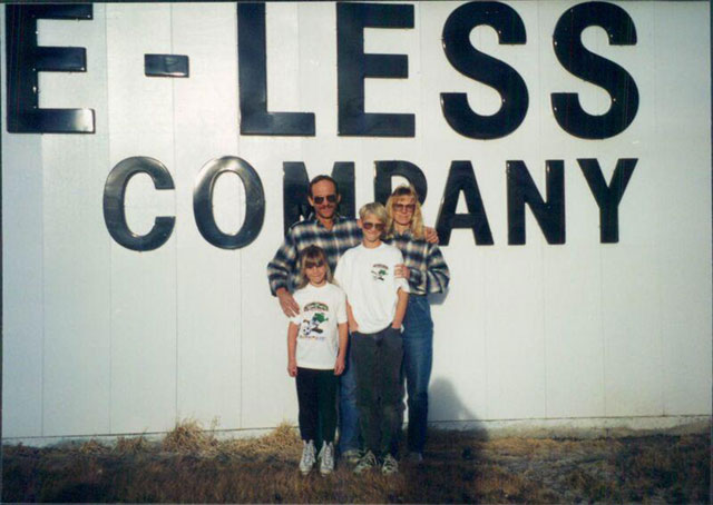 Loveless family in front of new building